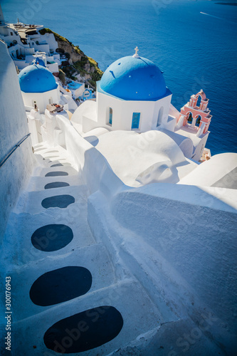 Traditional white architecture and greek orthodox churches with blue domes over Canvas Print