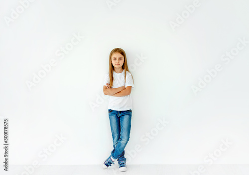 Obraz Cute little girl with crossed hands isolated on white - fototapety do salonu