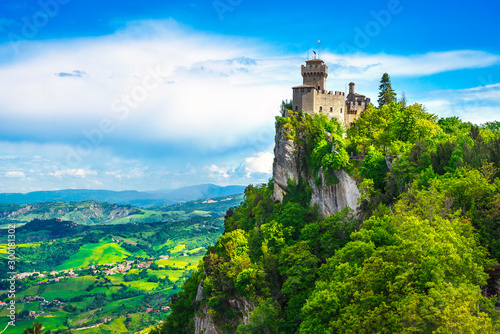 Fototapeta San Marino, medieval tower on a rocky cliff and panoramic view of Romagna obraz