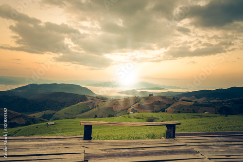 Garden Poster Rice fields Landscape images of wood balcony and morning light on high mountain range covers the green rice fields and white fog, to nature background concept.