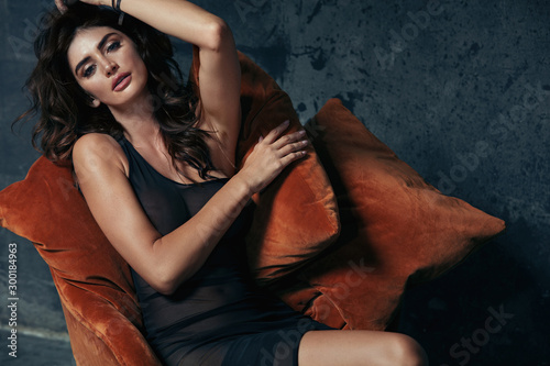 Portrait of a sensual brunette lady sitting on the antique armchair Wallpaper Mural