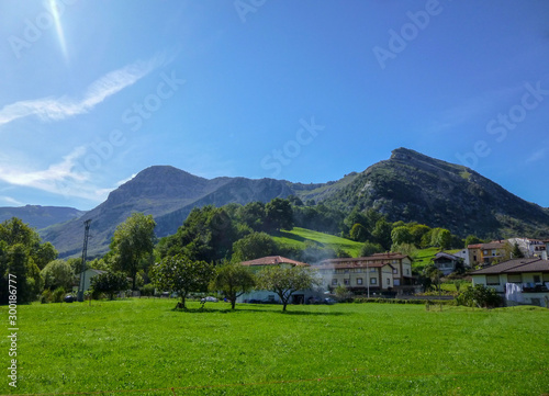 Cantabria landscape with field, montains, river and a small village. Spain