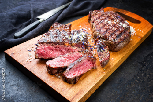Traditional barbecue dry aged wagyu entrecote beef steak sliced with salt and sp Fototapet