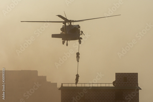 Military combat and war with helicopter flying into the chaos and destruction Wallpaper Mural