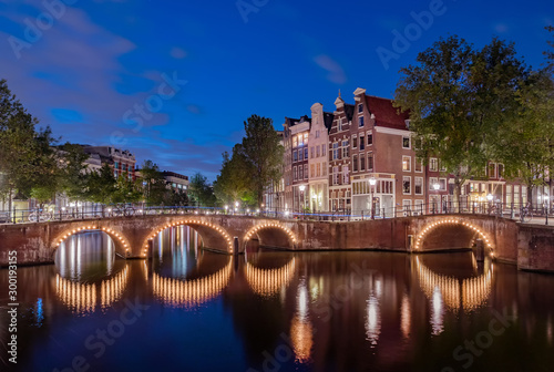 Photo  Panorama of the illuminated bridges on the channels at night