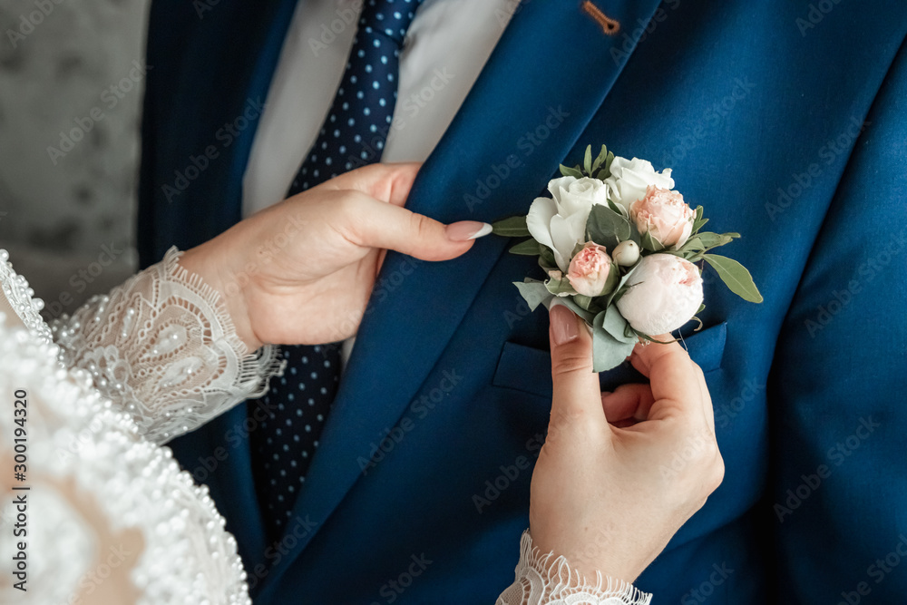 Fototapeta Boutonniere for the groom. The concept of marriage, family relationships, wedding paraphernalia.