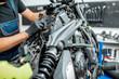 Electrician repairing motorcycle wiring