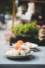 Asian Vietnameese Lunch. Fresh Vegan Rice Paper Summer Rolls On Table In Asian Cafe. Vietnamese, Oriental, Asian Vegetarian Food