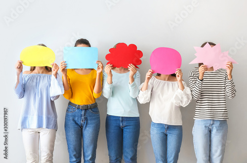 Women with speech bubbles on white background Wallpaper Mural