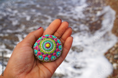 Photo  Beautiful hand painted mandala rock