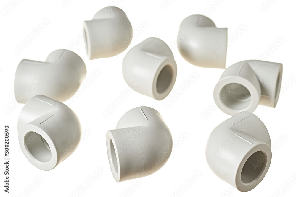 Fototapety, obrazy: Scattered polypropylene, plastic corners of 90 degree for connecting pipe for water or other liquid for heating room isolated on white background without shadow. Close-up