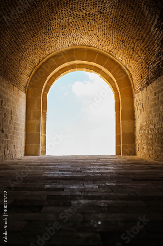 View of sky through stone archway. Ideal for compositing. Wallpaper Mural