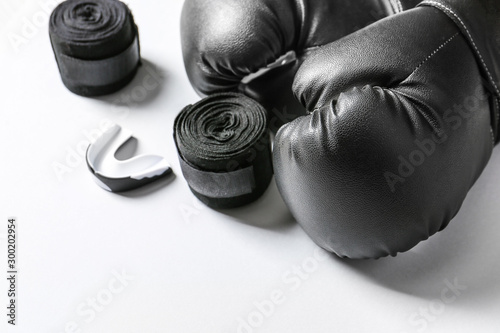 Boxing gloves, wrist bands and mouth piece on white background Canvas-taulu