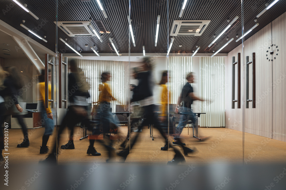 Fototapety, obrazy: Group of business people walking at modern open space. Team of business employees at coworking center. Motion blur. Concept work in process