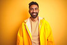 Young Indian Man Wearing Rainc...