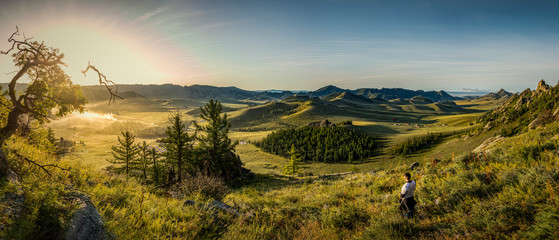 Gorkhi Terelj National Park Sunrise in Mongolia, with a campsite in the valle...