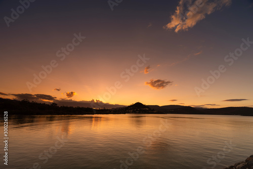 Airlie Beach Australia colorful sunset over the sea Wallpaper Mural