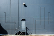 Clean Geometric Shapes Of Industrial Architecture - Back Door Entrance Into Warehouse Building
