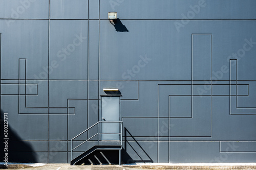 Clean geometric shapes of industrial architecture - back door entrance into ware Canvas Print