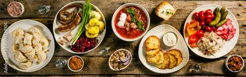 Cuadros en Lienzo Selection of traditional ukrainian food - borsch, perogies, potato cakes, pickle