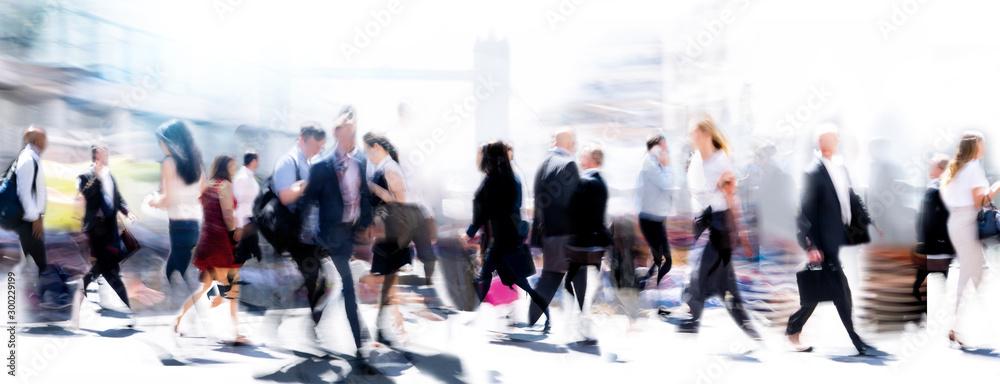 Fototapeta Walking people blur. Lots of people walking in the City of London. Wide panoramic view of people crossing the road.