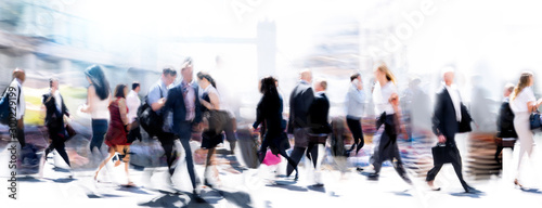 Walking people blur. Lots of people walking in the City of London. Wide panoramic view of people crossing the road.