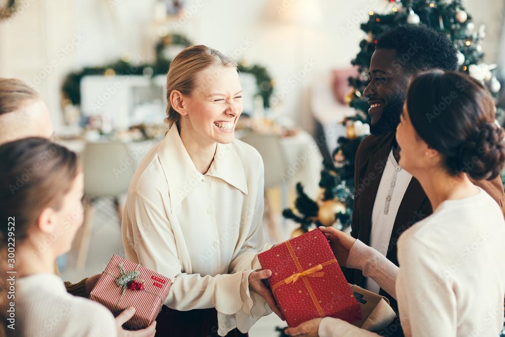 Fototapety, obrazy: High angle portrait of elegant young people exchanging gifts and laughing happily during Christmas party, copy space
