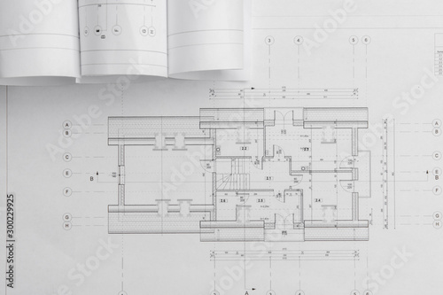Fototapeta Architect rolls and architectural plan,technical project drawing obraz