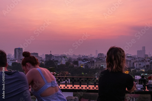 Foto auf Gartenposter Aubergine lila Hanoi city Skyline and cityscape captured during a beautiful Vietnamese sunset in October of 2019 from a skybar.