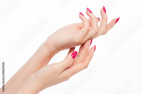 elegant female hands with red pink nails