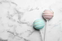 Sweet Colorful Cake Pops On White Background, Flat Lay. Space For Text