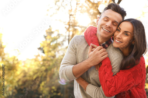 Happy couple in sunny park. Autumn walk