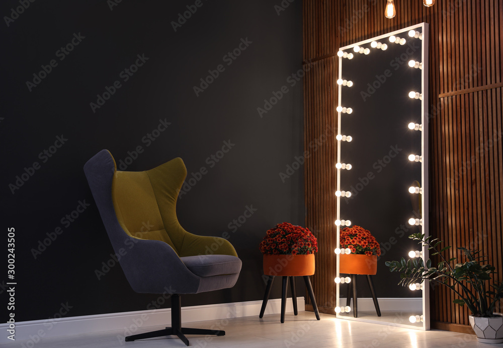 Fototapeta Large mirror with light bulbs in stylish room interior
