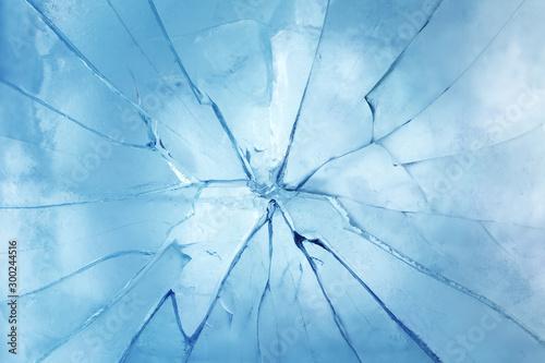 Fotografía Closeup of a cracked ice texture. Studio macro shot.