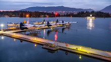Seaplanes Sightseeing Tours Vancouver, British Columbia, Canada. Docked Seaplanes In Harbor Ready For Tourist Flights.