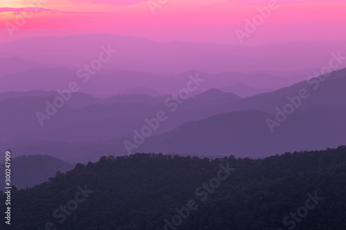 The blurred natural background of colorful twilight in the evening, on the high mountains, with many forests, provide fresh air and preserve the ecology.