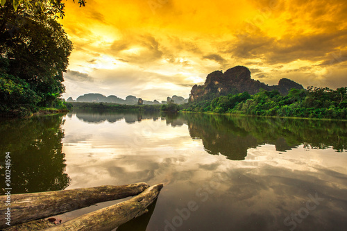 Foto auf Gartenposter Orange Natural background of a large reservoir in Krabi,Thailand(Nong Thale)atmosphere surrounded by mountains,trees of various sizes, blown through the wind,blurred cool during the day,a viewpoint of travel