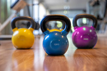 Colorful Kettlebells In A Row In A Gym,  Blue  Color , Pink Color,yellow Color