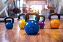 Colorful Kettlebells In A Row In A Gym,  Blue Color , Pink Color,yellow Color, Orange Color