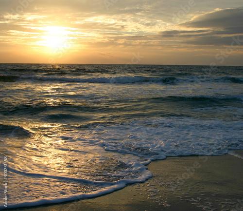 Valokuva Dark, Restless Tide at Sunset