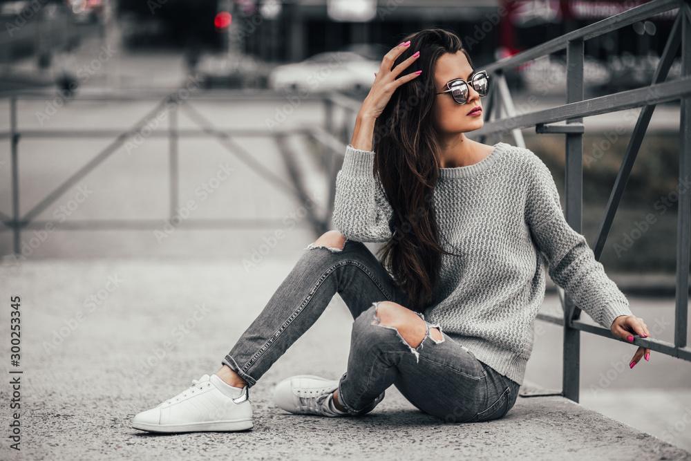 Fototapeta Beautiful girl posing in the street. Urban style. Street fashion.