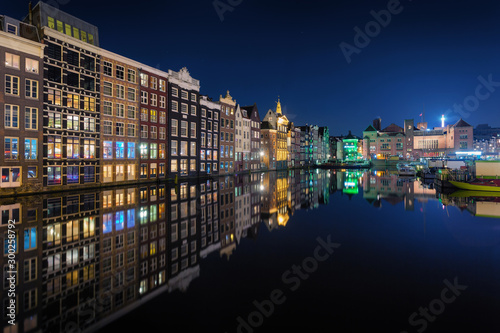 Vászonkép Beautiful traditional old buildings on canal in Amsterdam at night