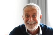 Portrait Of Happy Smiling Senior Man Looking At Camera