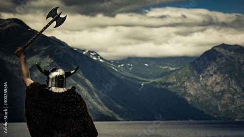 Leinwand Poster  Viking warrior on fjord shore, Norway