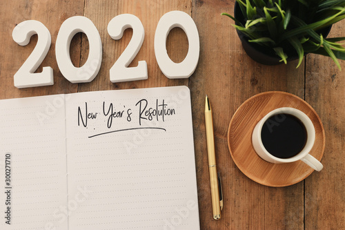 Business concept of top view 2020 year's resolution list with notebook, cup of c Fototapeta