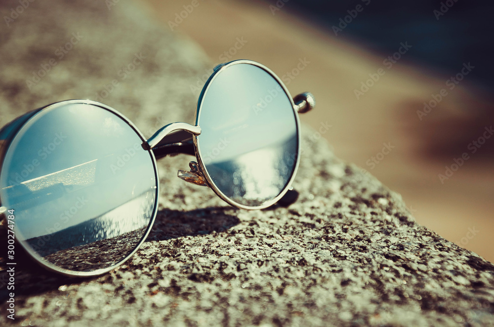 Fototapeta sunglasses on the beach