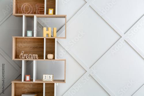 Fotomural  Stylish rack with decor near grey wall