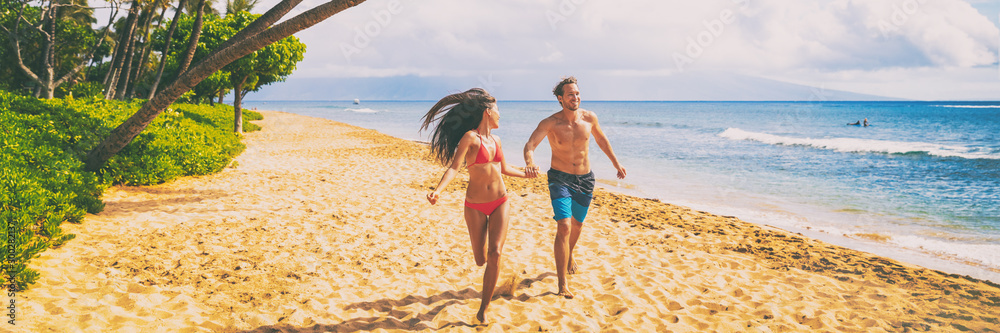 Fototapety, obrazy: Couple beach vacation banner walking happy travel vacation summer holiday panoramic. Young people holding hands having fun running on tropical getaway for winter holidays.