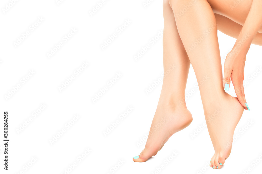 Fototapety, obrazy: Beautiful well-groomed female legs with mint manicure isolated on a white background