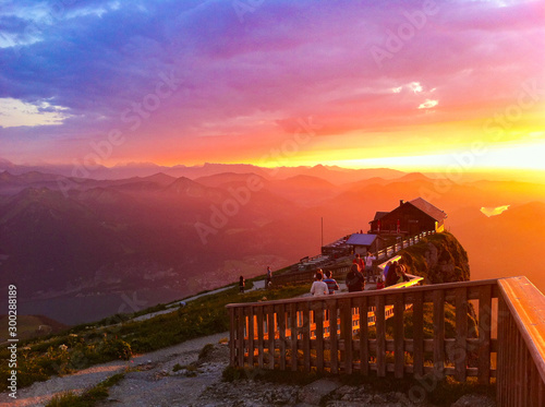 Foto auf Leinwand Braun Epic amazing beautiful sunset sunrise over Austrian Alps on top of Schafkopf Mountain with mountain top cottage cabin hut and mountain range in background